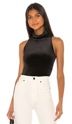 Commando Velvet Sleeveless Turtleneck Bodysuit In Black.