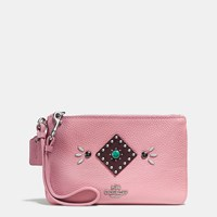 Coach Western Rivets Small Wristlet In Polished Pebble Leather Sv Pink