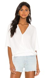Krisa Smocked Waist Surplice Top In White.