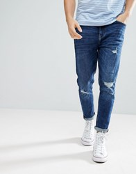 Bershka Skinny Tapered Jeans In Mid Blue Wash