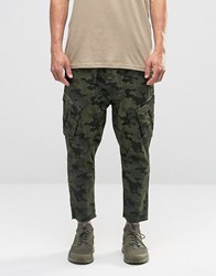 Asos Drop Crotch Cropped Cargo Trousers In Camo Camouflage Green