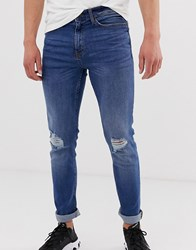 New Look Skinny Jeans With Knee Rips In Blue Wash