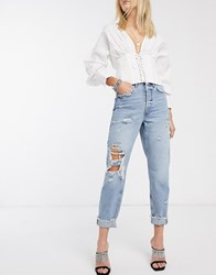 River Island Ripped Knee Mom Jeans In Mid Wash Blue