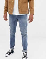 Boss Taber Tapered Fit Jeans In Mid Wash Blue