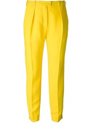 Carven Pleated Tapered Trousers Yellow And Orange