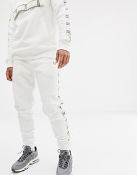 Criminal Damage Skinny Joggers In White With Check Side Stripe