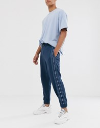 Tommy Jeans Cuffed Joggers In Washed Blue With Side Taping Navy