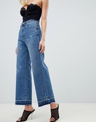 Prettylittlething Wide Leg Raw Hem Jeans In Blue Dark Wash