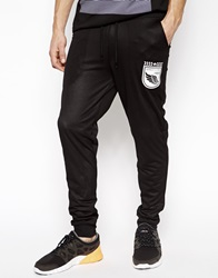 Asos Skinny Joggers In All Over Mesh With Sports Print Black