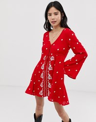 Kiss The Sky Embroidered Swing Dress