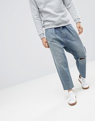 Asos Design Barrel Jeans In Mid Wash Blue With Rips Mid Wash Blue