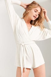 Silence And Noise Talia Surplice Belted Romper Tan