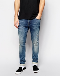 Asos Super Skinny Jeans In Jersey Mid Wash Blue