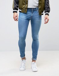 Asos Extreme Super Skinny Low Impact Jeans In Mid Blue Mid Blue