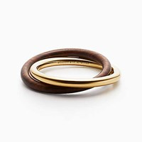 Tiffany And Co. Out Of Retirement Interlocking Bangle In 18K Gold Wood Medium.