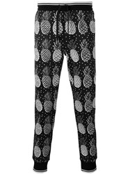 Dolce And Gabbana Pineapple Print Trousers Black