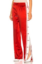 Monse Side Snap Track Pant In Red White Red White