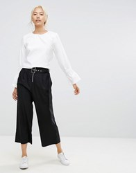 House Of Sunny Wide Leg Trousers With Eyelet Belt And Zip Detail Black