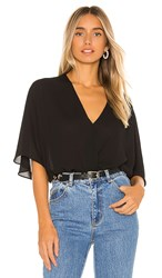 Krisa Smocked Waist Surplice Top In Black.