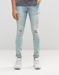 Asos Extreme Super Skinny With Knee Rips In Bleach Blue Bleach Blue