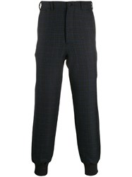 Alexander Mcqueen Check Print Tapered Trousers Black