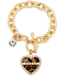 Guess Gold Tone Crystal Faux Leopard Charm Toggle Bracelet