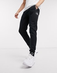 Calvin Klein Jeans Mix Media Tapered Joggers In Black
