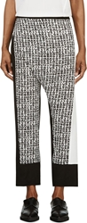 Cnc Costume National Black And White Text Graphic Wrap Panel Trousers