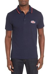 Lacoste Men's 'Sprinter Century' Graphic Pique Polo Navy Blue White Cochineal Red