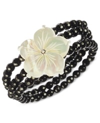 Macy's Onyx 122 Ct. T.W. And Mother Of Pearl 32 Mm Flower Stretch Bracelet In Sterling Silver