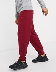 Adidas Originals Winterized Joggers With 3 Stripes In Burgundy Tech Pack Red