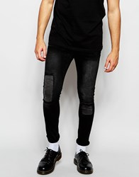 Asos Super Skinny Jeans Rip With Patches In Washed Black Black