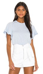 David Lerner Candice Flutter Sleeve Top In Baby Blue. Pacifica