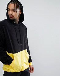 Asos Oversized Longline Hoodie In Fleece With Woven Panel And Toggle Hem Black