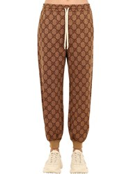 Gucci Gg Supreme Slim Fit Cotton Jersey Pants Camel