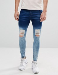 Illusive London Muscle Fit Jeans With Blue Fade And Distressing