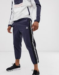 Reebok Meet You There Tapered Tape Joggers In Navy
