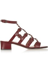Alaia Studded Leather Gladiator Sandals Red