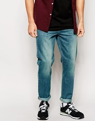 Asos Tapered Jeans In Mid Wash Midblue