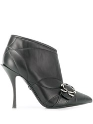 Dolce And Gabbana Quilted Buckled Leather Booties Black