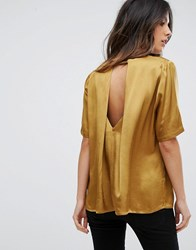 Soaked In Luxury Cut Out Back Metallic Blouse Gold