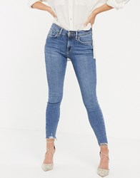 River Island Amelie Skinny Jeans With Raw Hem In Mid Blue