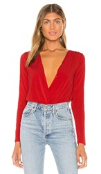 Bcbgeneration Surplice Bodysuit In Red. Electric Red