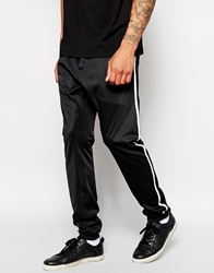 Solid Solid Drop Crotch Sweatpants With Varsity Stripe Black