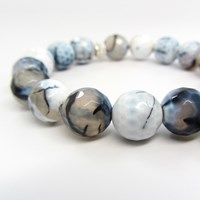 Dripping In Gems Pearl Horn Charm Braceletblue And White Fire Agate