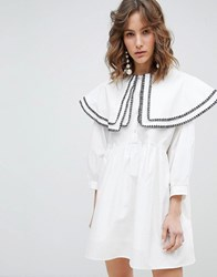 Sister Jane Smock Dress With Double Layer Bib In Cotton White