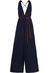 Caravana Pakkun Open Back Leather Trimmed Cotton Gauze Jumpsuit Navy