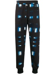 Alexander Mcqueen Printed Tapered Track Trousers Blue